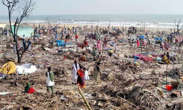 People looking for their belongings on Chennai Marina beach after the